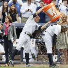 New York Yankees outfielder Brett Gardner douses teammate Alfonso Soriano after Soriano drove in the game-winning run in the ninth inning against the Tampa Bay Rays on July 28. The Yankees won 6-5.