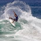 Nathaniel Curran makes a splash at the U.S. Open of Surfing on July 22 in Huntington Beach, Calif.
