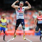 Richard Whitehead of Great Britain celebrates as he crosses the finish line in first place in the 200m during day three of the Sainsbury's Anniversary Games on July 28 in London.