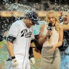 Chris Denorfia and sideline reporter Kelly Crull are doused following his pinch-hit walk-off two-run homer in the ninth inning of the Padres 2-1 win over the Reds.