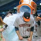 Jarred Cosart is doused by teammates J.D. Martinez (right) and Brandon Barnes as Astros sideline reporter Julia Morales moves out of the way. Cosart pitched eight scoreless innings and got the win in his major league debut in the Astros 2-1 victory over the Rays.