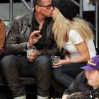 Rodriguez thinks this court side kiss with WWE diva Torrie Wilson at a January 2012 Lakers-Rockets game is just right.