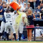 Brett Gardner is doused by teammate Alfonso Soriano following Gardner's game-winning home run in the ninth inning of the Yankees 5-4 win over the Tigers.