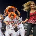 Brian Dozier is doused by teammates Oswaldo Arcia (left) and Trevor Plouffe as reporter Jamie Hersch moves out of the way. Dozier's RBI single in the 13th inning gave the Twins a 4-3 win over the Astros.