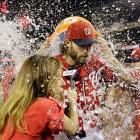 Jayson Werth and reporter Julie Alexandria are doused following the Nationals' 8-5 win over the Phillies. Werth hit a two-run homer in the seventh inning for his 1,000th hit.