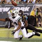 Jaguars cornerback Marcus Trufant breaks up a pass intended for Jets wide receiver Stephen Hill on Aug. 17.