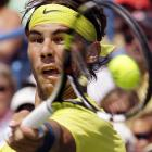 Rafael Nadal hits a forehand against John Isner during the finals of the Western & Southern Open on Aug. 18. Nadal won 7-6 (8), 7-6 (3).