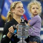 Kim Clijsters celebrated the 2010 with her daughter, Jada. Clijsters became the first mom to win the title since 1980 and did so by prevailing in her third tournament back from retirement.