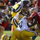 Eddie Lacy scored his first NFL touchdown on this play in which he barely got the ball across the plane before being pushed backward.
