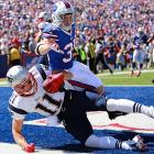 Julian Edelman's touchdown grab at the back of the end zone stood up upon review.