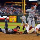 Phillies second baseman Chase Utley is tagged out at home by Nationals catcher Wilson Ramos in the eighth inning as reliever Craig Stammen tries to avoid a collision during Washington's 3-2 defeat of Philadelphia on Sept. 4.