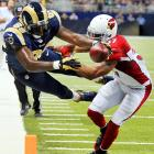 Rams tight end Jared Cook (89) vaults into the end zone past Cardinals safety Yeremiah Bell (37)on a 16-yard touchdown reception in the second quarter during St. Louis' 27-24 defeat of Arizona on Sept. 8. Cook caught seven passes in the game for 141 yards and two touchdowns.