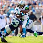 Seahawks safety Earl Thomas (29) puts his shoulder into stopping Panthers running back DeAngelo Williams during Seattle's 12-7 defeat of Carolina on Sept. 8.