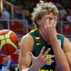 Lithuania's Mindaugas Kuzminskas was on the receiving end of an old school Three Stooges defensive maneuver by Latvia's Kaspars Berzins during a pitched battle during their match in Podmezakla Arena, Slovenia.