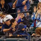 Fans at Safeco Field in Seattle put on a dazzling display of telekinetic powers to keep the bat of Mariner Kendrys Morales suspended indefinitely. See? It hasn't moved yet, has it?