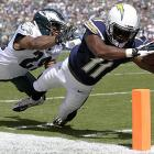 Eddie Royal of the Chargers got this ball across the plane for one of his three touchdowns against the Eagles.