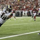 St. Louis wide receiver Austin Pettis scored ahead of Atlanta Falcons cornerback Robert McClain.