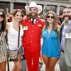 Tourists Elaine Oliveira, Zuleika Riveron and Daniele Alfonso cozied up to the hirsute Paul Roof and Derek Nehrbass during the annual tourney's opening parade through the French Quarter in N'awluns. Contestants faced off in 18 categories including Dali, full beard natural, and sideburns.