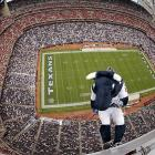 Not to be outdone by the Red Bull Flugtag folks, the Houston Texans mascot hit new heights at Reliant Stadium while introducing the team's AFC South Division title banner during a game against the Tennessee Titans.