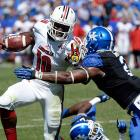 Louisville junior running back Dominique Brown stiffarms Alvin Dupree during the Cardinals' decisive 27-13 victory over in-state rival Kentucky.