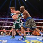 """Floyd Mayweather Jr. delivers a vicious right to Canelo Alvarez on his way to another victory. The fight, billed as """"The One,"""" shattered the record for highest-grossing pay-per-view fight by generating $150 million in revenue."""