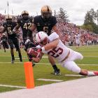 Stanford senior running back Tyler Gaffney dives for the end zone but steps out of bounds at 2-yard-line. Gaffney got another chance, scoring on the next play, and the Cardinal beat Army comfortably, 34-20.
