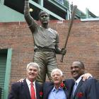 Carl Yastrzemski was always a man of very few words and hardly showed emotion during his playing days. The latest honor even touched him. The Boston Red Sox honored the Hall of Famer with a statue outside the right field entrance of Fenway Park on Sunday morning. Former teammates, including Hall of Famer Jim Rice (right) and outfielder Dwight Evans (left) were on hand.