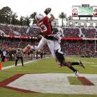Stanford wide receiver Rollins Stallworth leaps over Arizona State cornerback Osahon Irabor but fails to make the catch. Stanford won comfortably, 42-28.