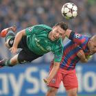 FC Schalke's Marco Hoeger, left, jumps for a header with Steaua Bucuresti's Alexandru Bourceanu, right, during a Champions League Group E match in Gelsenkirchen, Germany. Schalke won 3-0.
