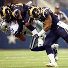 St. Louis Rams cornerback Janoris Jenkins (21) and linebacker Alec Ogletree (52) team up to bring down Dallas Cowboys wide receiver Miles Austin. The Rams struggled to stop the Cowboys for most of the day, losing 31-7.