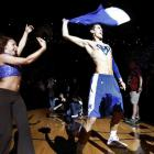 Memphis' Drew Barham rips off his jersey to show his superman style ''M'' painted on his chest while being introduced during Memphis Madness at the The FedExForum in 2011.