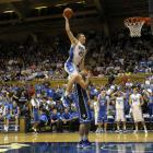 """Duke's Miles Plumlee pushes off his younger brother Marshall during a dunk contest at the """"Countdown to Craziness"""" preseason NCAA college basketball event in Durham."""