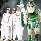 Michigan State coach Tom Izzo, arrives with daughter Racquel, wife Lupe, and mascot Sparty during the Spartans' 2010 NCAA college basketball midnight madness festivities.