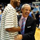 North Carolina coach Roy Williams hugs former player Vince Carter during Late Night with Roy at the Dean Smith Center in 2011.