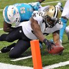 Saints tight end Ben Watson got this ball across the line before his knee touched down at the one.