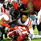 Mississippi's Cody Prewitt loses his helmet as he tackles Alabama running back Kenyan Drake.