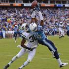Tennessee Titans wide receiver Justin Hunter uses every bit of his 6-4 frame to bring in a 16-yard touchdown pass as he is defended by New York Jets cornerback Darrin Walls.