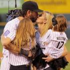 Todd Helton of the Colorado Rockies kisses his wife, Christy, as they are joined by daughers Tierney Faith (left) and Gentry Grace during pregame ceremonies before Helton's final home game at Coors Field. Helton retires as the Rockies' all-time leader in games played, hits, home runs and RBI.