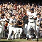 San Francisco Giants second baseman Tony Abreu celebrates as he scores the winning run on a single by Hunter Pence in the Giants' regular season finale.