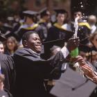 Patrick Ewing pops a champagne bottle during his graduation ceremony at Georgetown in May 1985.