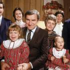 North Carolina basketball coach Dean Smith poses with his family in November 1982.