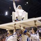 Kansas alum and movie star Rob Riggle is carried in by cheerleaders as he emcee'd for the men's basketball team skits during the University of Kansas Late Night at Phog Allen Fieldhouse in Lawrence, Kan., on Oct. 4, 2013. NCAA rules allow teams an earlier start this year. Here's a look back at some other Midnight Madness events over the years.