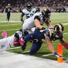 Lance Kendricks of the Rams got this ball across the plane of the end zone before his knee touched down.