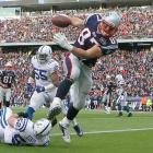 """With three touchdowns, tight end Rob Gronkowski nearly covered the spread himself. The Patriots led 31-3 after the third quarter. But the winless Colts fought back. They scored three touchdowns in the fourth quarter -- two on passes from Dan Orlovsky to Pierre Garcon -- and New England needed Deion Branch to recover an onside kick in the final minute to seal a 31-24 win. """"People can say what they want to say about not playing hard,"""" Colts tight end Jacob Tamme told the Associated Press afterward. """"But I think that [comeback] pretty much shut that up right there."""" The Colts were 16.5-point underdogs against the Ravens the following week (Baltimore didn't cover the spread but won 24-10)."""