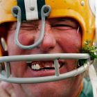 Sporting a dab of ketchup and a dollop of spinach from the concession stand, Randy Domres attempted to impersonate Ray Nitschke before his beloved Packers tackled the Detroit Lions in Green Bay.
