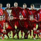 Russia qualified for its first World Cup since 2002 with a 1-1 draw against Azerbaijan in Baku. Roman Shirokov scored Russia's only goal 16 minutes into the contest, while Azerbaijan's Vagif Dzavadov made things a bit more tense in the closing stages with a 90th minute header to level the scores. Had Azerbaijan somehow netted a winner, Russia would have been condemned to the UEFA playoffs.
