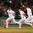 The Red Sox celebrate with Jarrod Saltalamaccha after his walk-off single to win Game 2 of the ALCS.