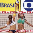 Carolina Salgado of Brazil and Julia Grossner of Germany in action during day four of the FIVB Beach Volleyball Sao Paulo Grand Slam 2013.
