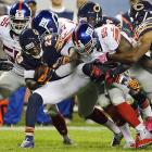 New York Giants defenders gang up to tackle Chicago Bears return man Devin Hester. Hester and the Bears won 27-21, dropping the Giants to 0-6.