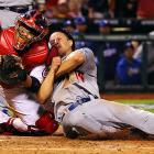 St. Louis Cardinals catcher Yadier Molina blocks the plate and tags out Los Angeles Dodgers second baseman Mark Ellis in the 10th inning of Game 1 of the NLCS. The Cardinals won in the 13th inning.